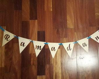 Garland wooden letters hanging on ribbon. Ramadan, Eid, Mubarak, Happy, Eid Al Fitr Adha, Birthsday, custom writing