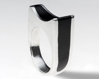 Handmade sterling silver ring with black resin.