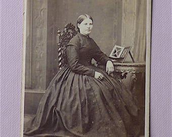 Carte-de-visite, antique.  Featuring a seated lady. E. Gregson, Waterhouse St. Halifax. c1860s.