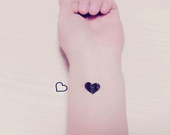 Tiny tattoo etsy for Black heart outline tattoo meaning