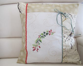 Cushion with beige and white upholstery