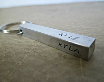 mens four sided hand stamped aluminum bar pendant keychain with your choice of names or short messages