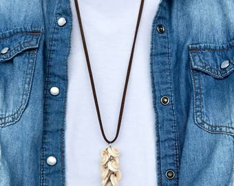 Boho country suede cord necklace with shell cluster pendant. Long cord can be tied to any length or tied around for double layered look.