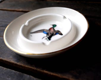 Wildlife art. Vintage 70s off white porcelain ashtray with a hand colored duck print of Dennis Puleston by Delano Studios.