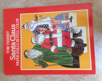 Paper Doll book by Tom Tierney- 1983 Santa Claus portrayed through history- Un cut- Nice condition.  Extras incuded.