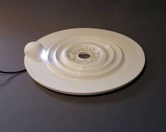 White ceramic disc with lighting