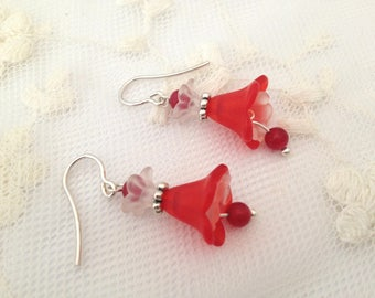 925 silver earrings and red lucite flowers.