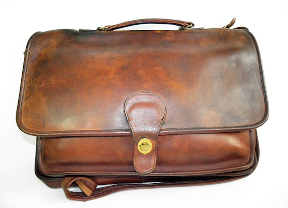 https://www.etsy.com/listing/549359075/1980s-unisex-coach-distressed-leather?ref=shop_home_active_14