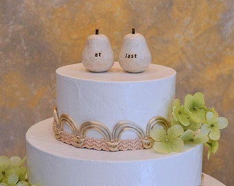 """Wedding cake topper...""""at last"""" pears ... pears can be made any color you want, tell the world you two are a perfect pair"""