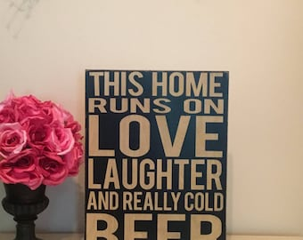 This home runs on love laughter and really cold beer - wood sign -Funny drinking sign - man cave -fence sign -bar sign - home warming gift -