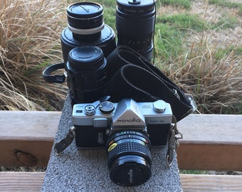 Minolta SR-1s with 3 lenses 50mm, 28mm, 75-205mm and 2 teleconverters