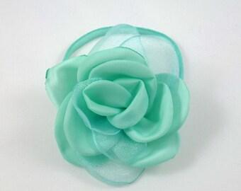 Green bracelet with flower - or hair elastic