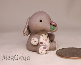 Cute Elephant Miniature Sculpture with Polka Dots on her Tummy, holding a pink morning glory flower.  Hand painted & hand sculpted OOAK