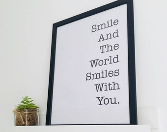 Smile and the world smiles with you - Black / White Framed Inspirational Quote.