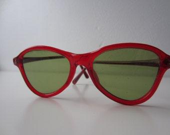 1950's children's burgundy plastic Cool Ray sunglasses with green glass lenses