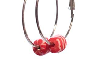 Hoop earrings with red and white glass beads
