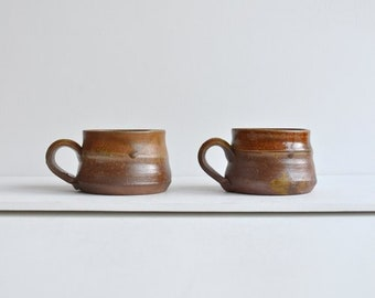 Vintage coffee cups with a lovely handmade charm.
