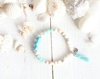 Nazaré bracelet, elastic wire, beads, turquoise, blue, white, cream, pompom, beach style, summer jewel, for women