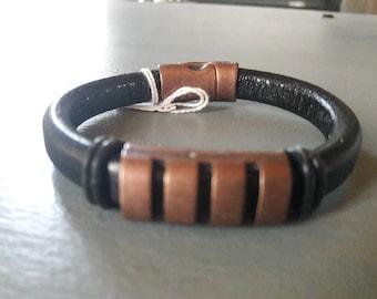 Black thick leather strap.  copper. men's bracelet