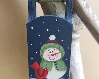 Wooden Snowman Sled Ornament