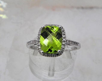 AAAA Peridot Cushion Cut   9x7mm  2.15 Carats   14K white gold Halo Engagement Ring set with .15 carats of diamonds.  READY 2 SHIP