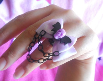 Pastel goth bat and skull ring purple