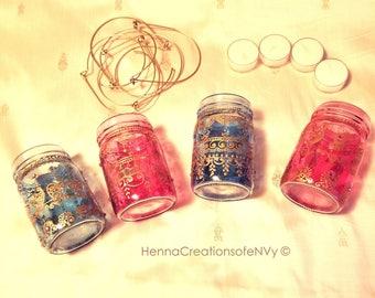 Set of 2 Arabic Mason Jar Lanterns in Ocean Blue Glass with Gold Arabic Henna Design Detailing.