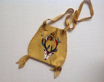 Small leather bag painted and beaded