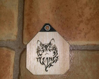 Pendant with stylized cat in leather and wood