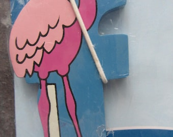 "Adhesive letter painted wood - representing the letter ""F"" as a flamingo"
