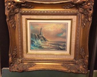 Vintage Glass Framed Print of Lighthouse Seascape