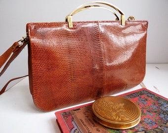 Golden handle leather and snakeskin brown shoulder bag