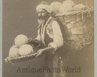 Cantaloupe melon seller with basket Turkey antique ethnic type photo