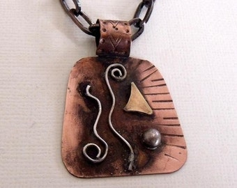 Copper pendant necklace with sterling silver and brass accents
