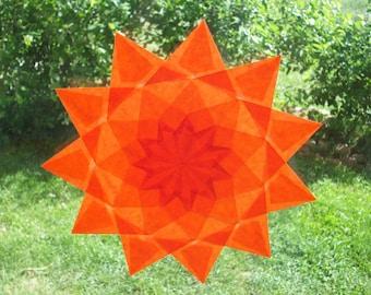 Window star, model 'Calendula', folded paper, transparency, seasonal, Waldorf, Montessori sensorial awakening table.