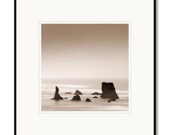 Bandon Beach, Oregon Coast, seatstacks, waves, photography, black and white, sepia warm tone, minimalist, framed photo by Adrian Davis