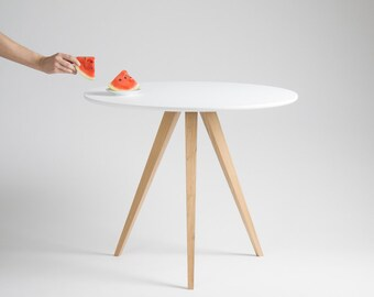 Round white table, dining table, with solid oak legs