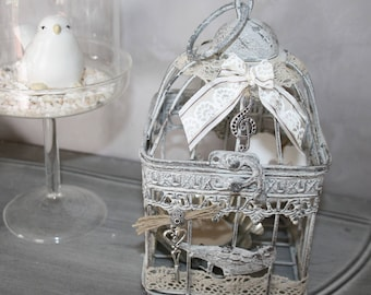 Decorative bird cage with candle