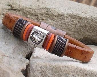 The greek owl symbol on this leather bracelet