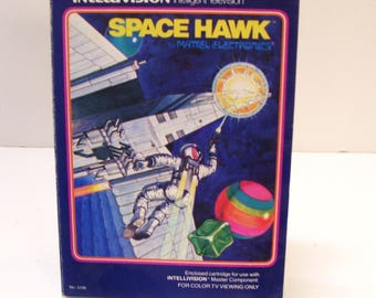 1981 Space Hawk Intellivision Cartridge , Manual , and 2 Controller Overlays, all in the Original Box