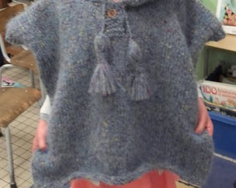 Adorable warm poncho for girl