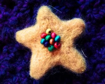 Beaded Star brooch.