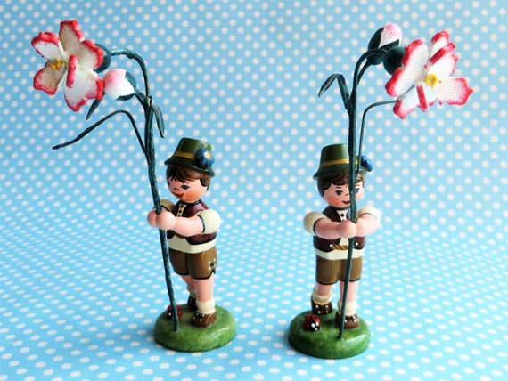 A pair of German Erzgebirge boys with flowers