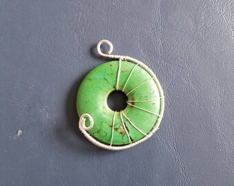 Green stone wrapped in sterling silver