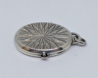 Sterling silver starburst 1970s oval shaped locket hallmarked