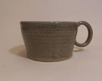 Small coffee cups, glazed in celadon green.