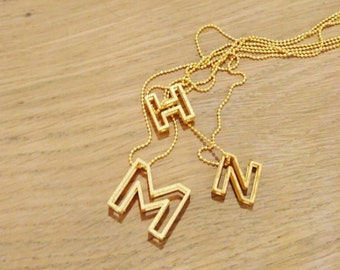 3D printed gold letter pendant