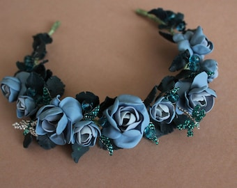 Wreath with blue roses and dragonfly
