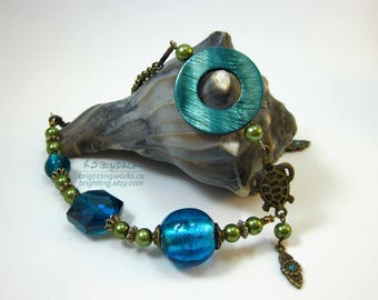 Sea Greens Blue; Turtle Charm Necklace with Green Glass Pearls, Bronze Charms & Findings, Dyed Shell and Brilliant Sea Blue Glass Features