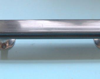 A 1950's art deco style plastic/bakelite door pull